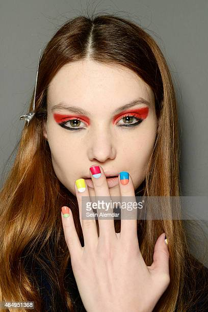A model is seen backstage ahead of the Au Jour Le Jour show during the Milan Fashion Week Autumn/Winter 2015 on March 1 2015 in Milan Italy
