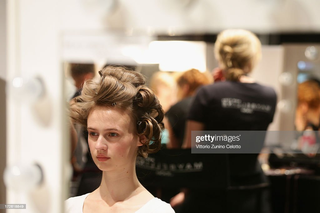 A model is seen backstage ahead of the Dietrich Emter Show during the Mercedes-Benz Fashion Week Spring/Summer 2014 at Brandenburg Gate on July 4, 2013 in Berlin, Germany