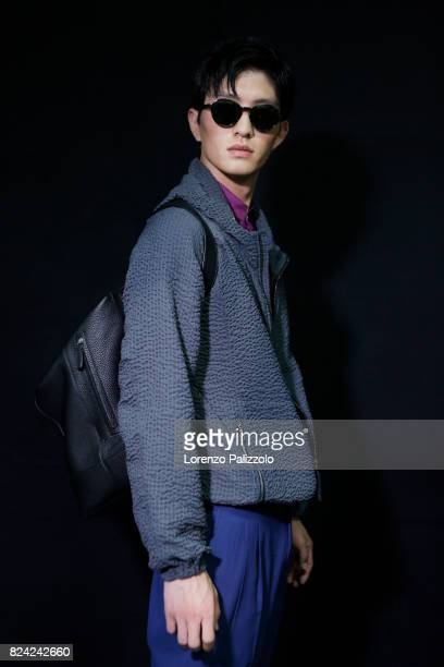 A model is seen backstage ahead of the Giorgio Armani show during Milan Men's Fashion Week Spring/Summer 2018 on June 19 2017 in Milan Italy