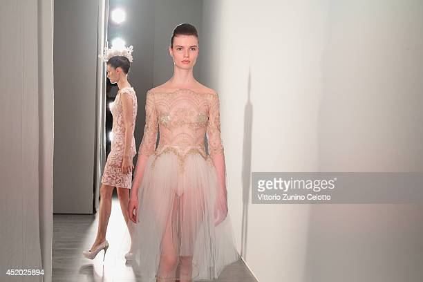 A model is seen backstage ahead of the Irene Luft show during the MercedesBenz Fashion Week Spring/Summer 2015 at Erika Hess Eisstadion on July 11...