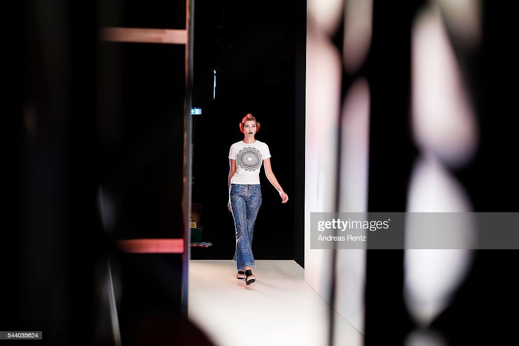 A model is seen backstage ahead of the Jeans For Refugees By Johny Dar show during the Mercedes-Benz Fashion Week Berlin Spring/Summer 2017 at Erika Hess Eisstadion on July 1, 2016 in Berlin, Germany.