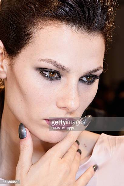 A model is seen backstage ahead of the John Richmond show during the Milan Fashion Week Autumn/Winter 2015 on March 1 2015 in Milan Italy