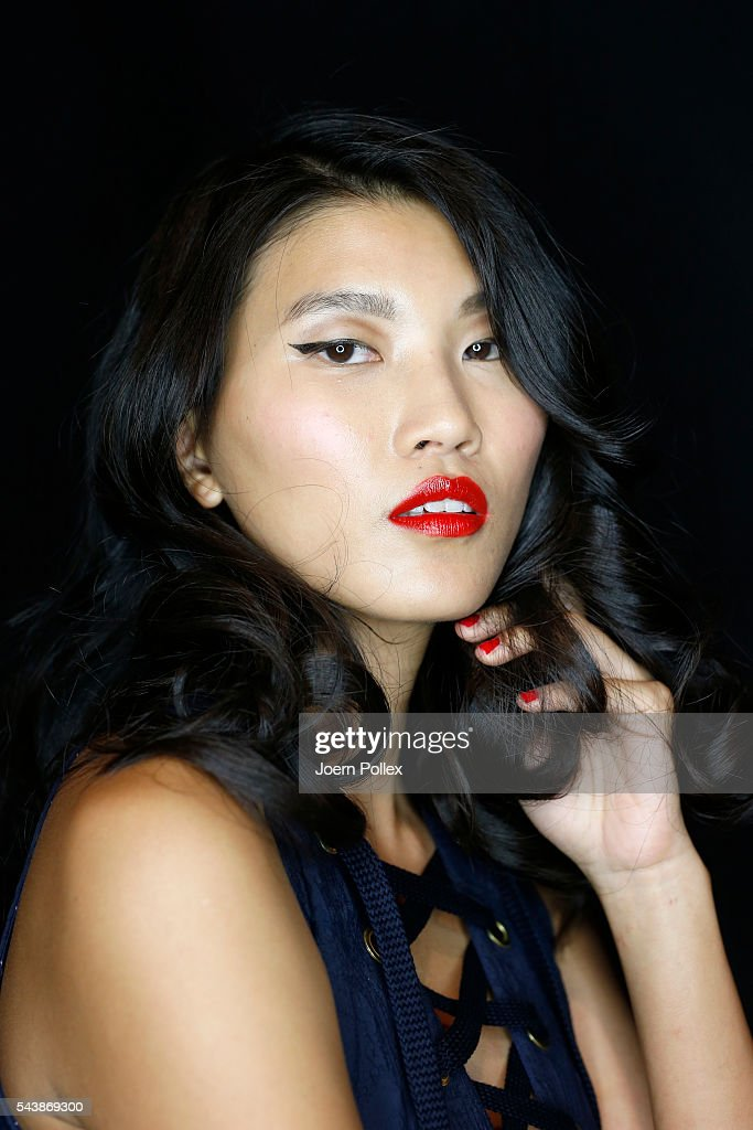 A model is seen backstage ahead of the Lena Hoschek show during the Mercedes-Benz Fashion Week Berlin Spring/Summer 2017 at Erika Hess Eisstadion on June 30, 2016 in Berlin, Germany.