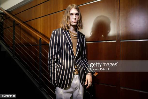 A model is seen backstage ahead of the Salvatore Ferragamo show during Milan Men's Fashion Week Spring/Summer 2018on June 18 2017 in Milan Italy