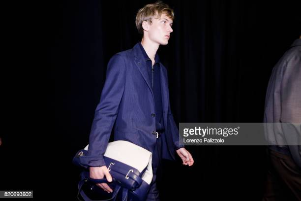 A model is seen backstage ahead of the Salvatore Ferragamo show during Milan Men's Fashion Week Spring/Summer 2018 on June 18 2017 in Milan Italy