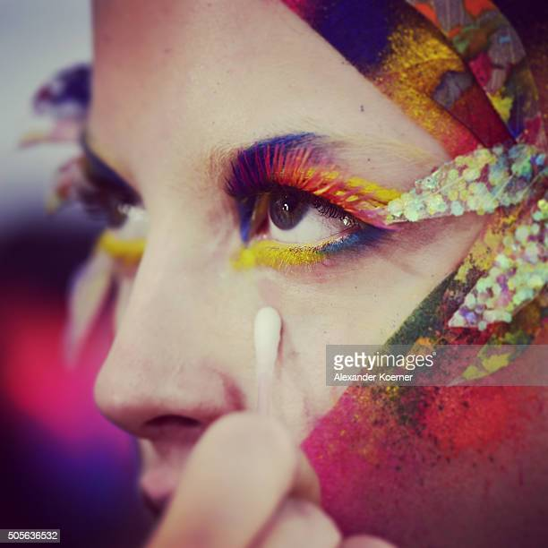 A model is seen backstage ahead of the 'The Power Of Colors MAYBELLINE New York MakeUp Runway' show during the MercedesBenz Fashion Week Berlin...