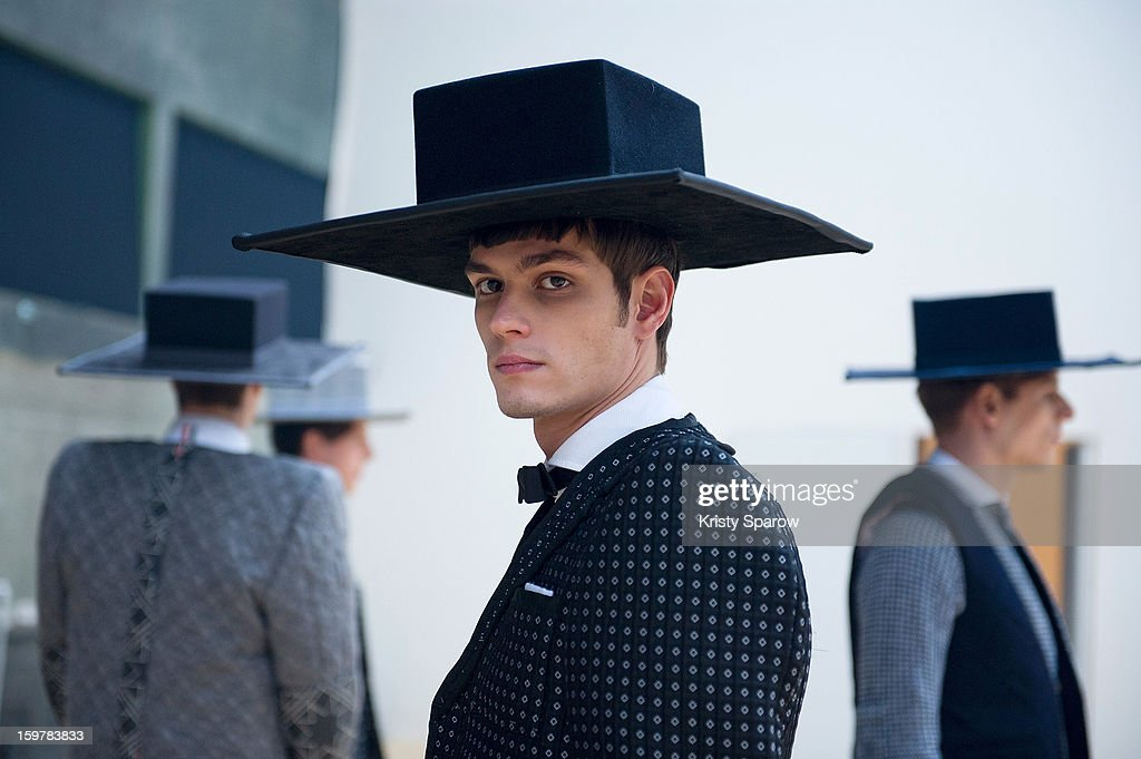 A model is seen backstage before the Thom Browne Menswear Autumn / Winter 2013/14 show as part of Paris Fashion Week on January 20, 2013 in Paris, France.