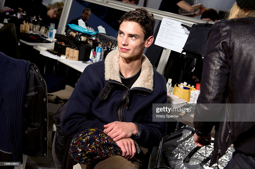 A model is seen backstage before the Viktor & Rolf Menswear Autumn / Winter 2013/14 show as part of Paris Fashion Week on January 17, 2013 in Paris, France.