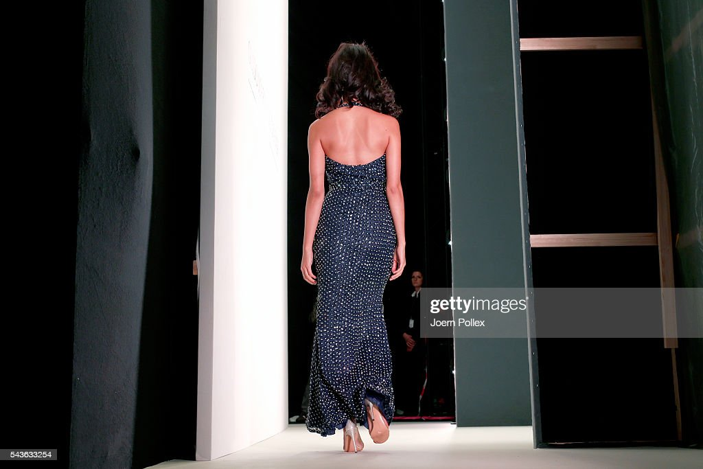 A model is seen backstage during the Guido Maria Kretschmer show during the Mercedes-Benz Fashion Week Berlin Spring/Summer 2017 at Erika Hess Eisstadion on June 29, 2016 in Berlin, Germany.
