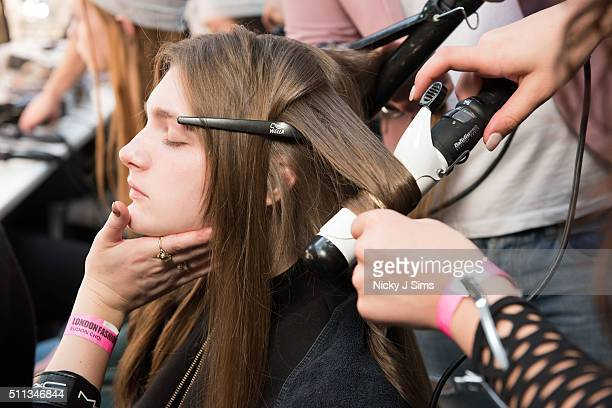 A model is seen backstage prior to the Eudon Choi show on day 1 of London Fashion Week Autumn Winter 2016 at BFC Showspace on February 19 2016 in...