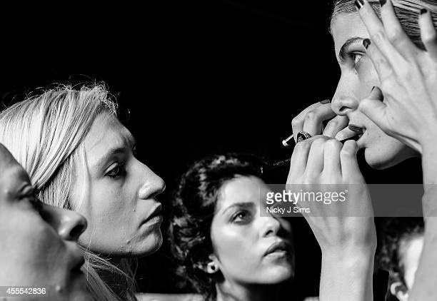 Image has been converted to black and white A model is seen backstage prior to the Isabel Garcia show during London Fashion Week Spring Summer 2015...