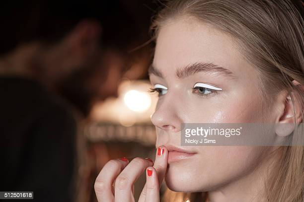 A model is seen backstage prior to the Xiao Li show on day 5 of London Fashion Week Autumn Winter 2016 at BFC Showspace on February 23 2016 in London...