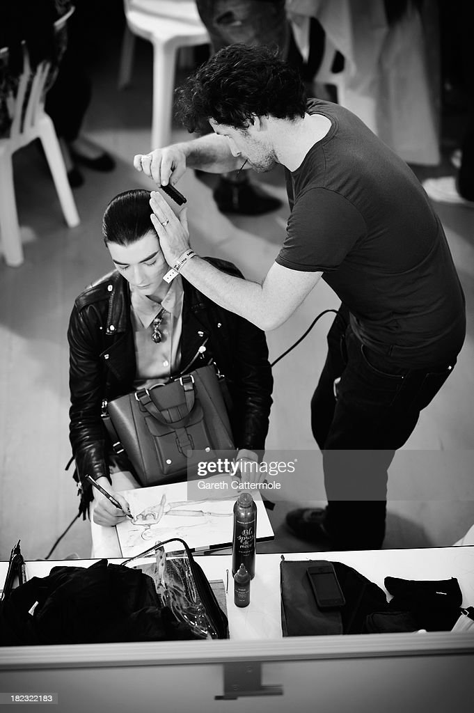 A model is seen drawing backstage before the John Galliano show as part of Paris Fashion Week Womenswear Spring/Summer 2014 on September 29, 2013 in Paris, France.
