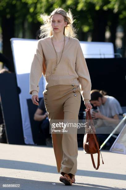 A model is seen modeling for a 'Chloe' photoshoot on the Alexandre III bridge on April 7 2017 in Paris France