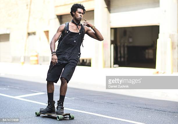A model is seen outside the Parke Ronen show wearing black overalls during New York Fashion Week Men's S/S 2017 Day 4 on July 14 2016 in New York City