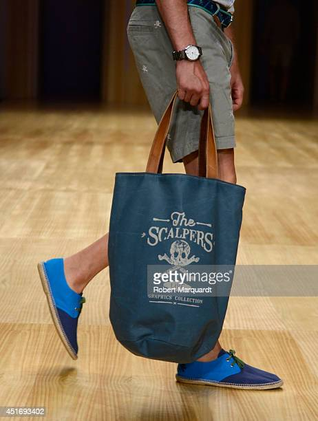 A model is seen walking the runway for the latest collection by 'Scalpers' at the 080 Barcelona Fashion Week 2014 on July 4 2014 in Barcelona Spain