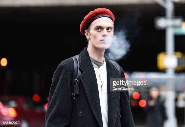 A model is seen wearing a red beret outside of the Rochambeau show during New York Fashion Week Men's AW17 on February 1 2017 in New York City