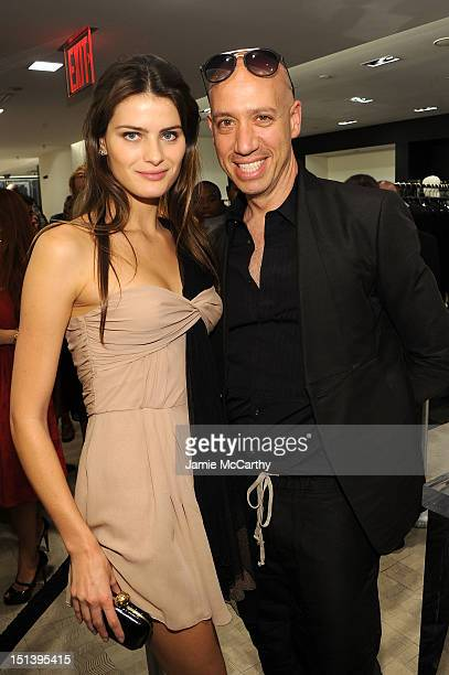 Model Isabeli Fontana and stylist Robert Verdi attend Bergdorf Goodman Celebrates Fashion's Night Out at Bergdorf Goodman on September 6 2012 in New...
