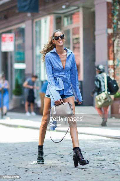 Model Izabel Goulart is seen wearing a CO/MUN shirt Rag Bone jean shorts Louis Vuitton shoes and sunglasses with a Fendi handbag in SoHo on August 19...