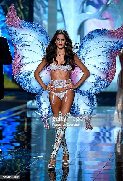 Model Izabel Goulart walks the runway at the annual Victoria's Secret fashion show at Earls Court on December 2 2014 in London England