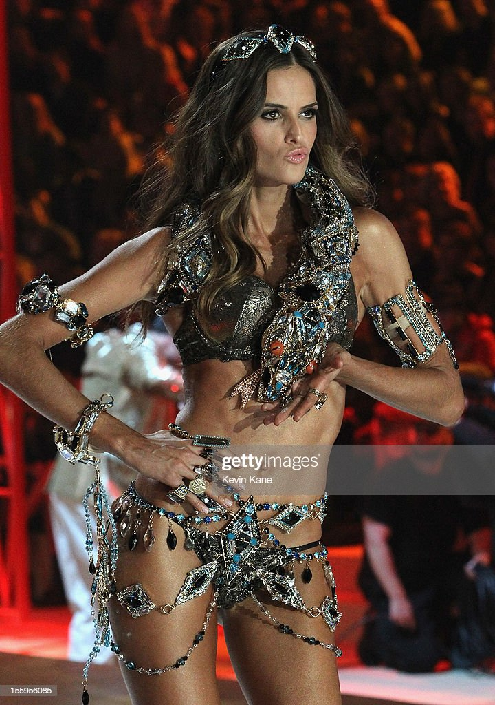 Model <a gi-track='captionPersonalityLinkClicked' href=/galleries/search?phrase=Izabel+Goulart&family=editorial&specificpeople=566749 ng-click='$event.stopPropagation()'>Izabel Goulart</a> walks the runway during the 2012 Victoria's Secret Fashion Show at the Lexington Avenue Armory on November 7, 2012 in New York City.