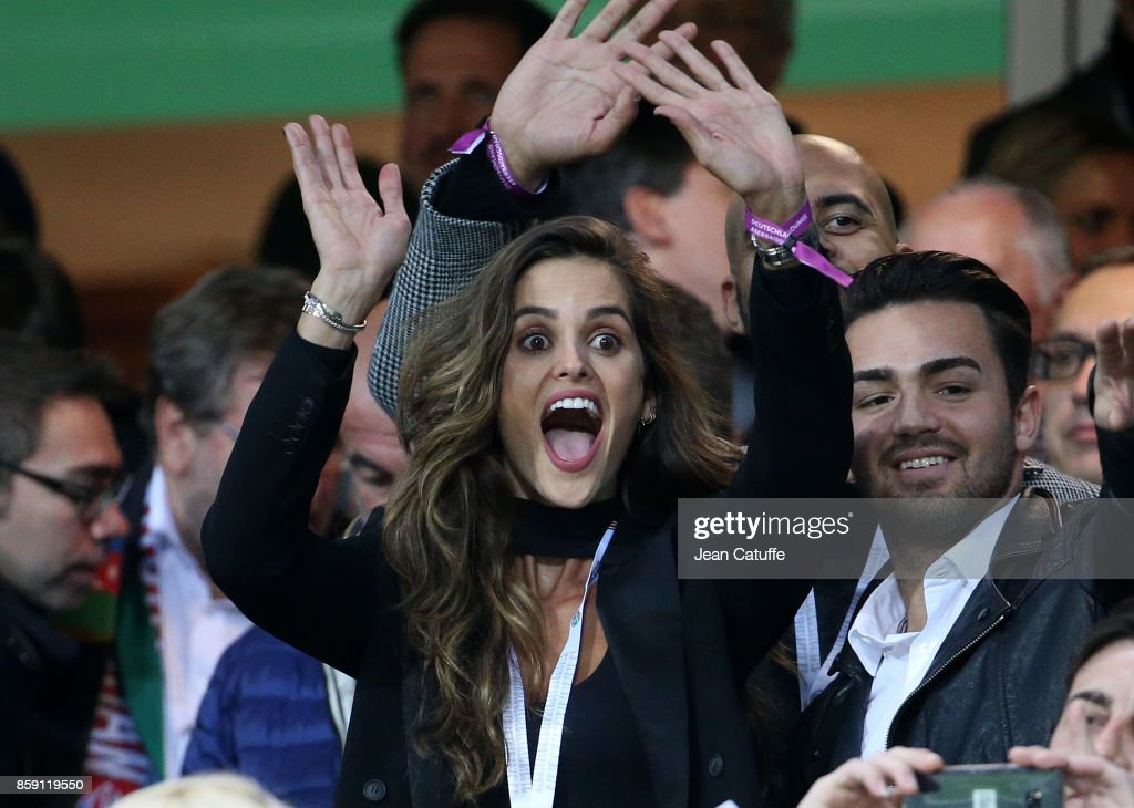 Model Izabel Goulart waves and sends kisses to boyfriend Kevin Trapp, goalkeeper of Germany when he salutes her from the pitch before the FIFA 2018 World Cup Qualifier between Germany and Azerbaijan at Fritz-Walter Stadium on October 8, 2017 in Kaiserslautern, Germany.
