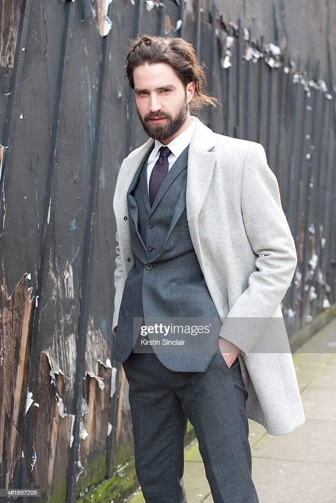 Model Jack Guinness wears a Cos coat, Austin Reed suit and Gucci tie and shirt day 3 of London Mens Fashion Week Autumn/Winter 2014, on January 08, 2014 in London, England.