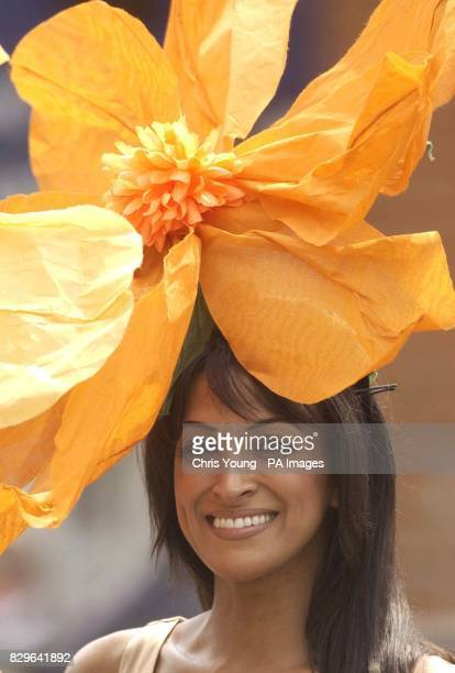 Model Jackie St Clair shows off a hat which she fashioned out of a lampshade at Royal Ascot during the first day of the Internationally renowned...