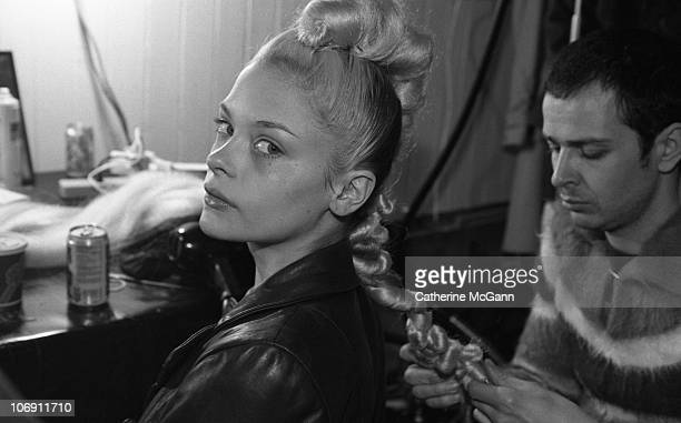 Model James King having her hair styled backstage at British fashion designer Alexander McQueen's first New York fashion show at a former synagogue...