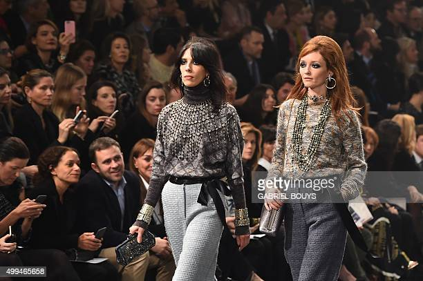 US model Jamie Bochert and french model Audrey Marnay present creations during the 12th Chanel Metiers dArt show 'ParisRome' an annual event to honor...