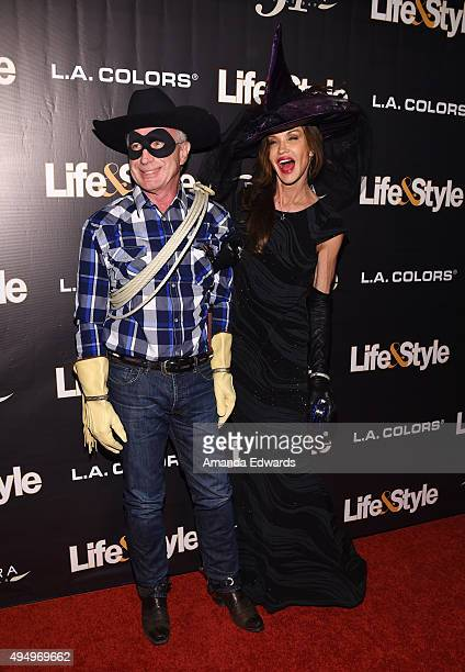Model Janice Dickinson and Dr Robert 'Rocky' Gerner arrive at the Life Style Weekly's 'Eye Candy' Halloween Bash hosted by LeAnn Rimes at Riviera 31...