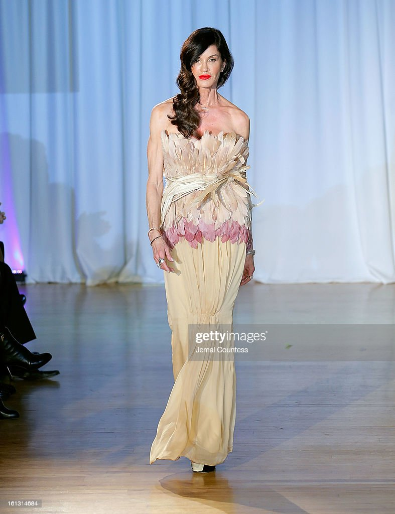 Model <a gi-track='captionPersonalityLinkClicked' href=/galleries/search?phrase=Janice+Dickinson&family=editorial&specificpeople=208845 ng-click='$event.stopPropagation()'>Janice Dickinson</a> walks the runway at the Reality of FASHION the Reality of AIDS fall 2013 fashion show during Mercedes-Benz Fashion Week at the Altman Building on February 9, 2013 in New York City.