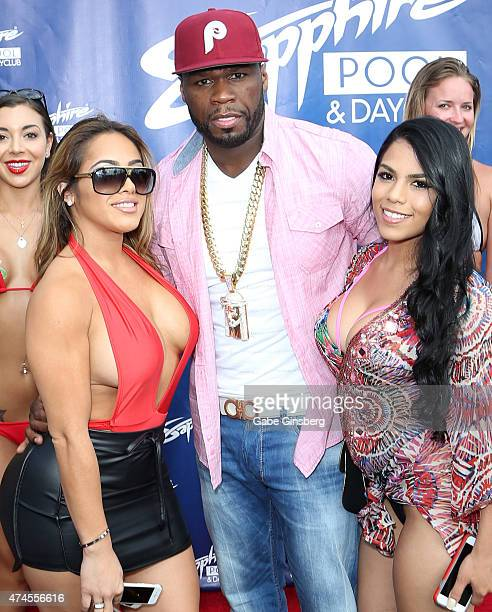 Model Jasmin Cadavid rapper Curtis '50 Cent' Jackson and model Elizabeth Ruiz surrounded by Sapphire models arrive at the Sapphire Pool Day Club on...
