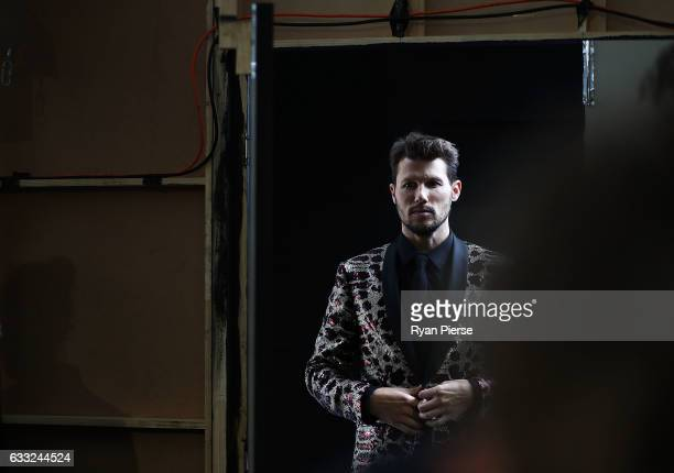 Model Jason Dundas prepares backstage during rehearsal ahead of the David Jones Autumn/Winter 2016 Fashion Launch at St Mary's Cathedral on February...