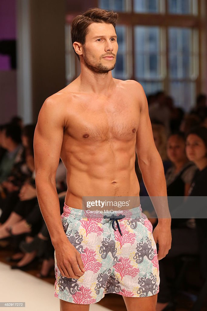 Model <a gi-track='captionPersonalityLinkClicked' href=/galleries/search?phrase=Jason+Dundas&family=editorial&specificpeople=578396 ng-click='$event.stopPropagation()'>Jason Dundas</a> showcases designs by The Rocks Push during a rehearsal ahead of the David Jones Spring/Summer 2014 Collection Launch at David Jones Elizabeth Street Store on July 30, 2014 in Sydney, Australia.