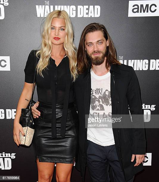 Model Jennifer Akerman and actor Tom Payne attend the live 90minute special edition of 'Talking Dead' at Hollywood Forever on October 23 2016 in...