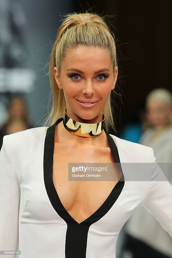 Model Jennifer Hawkins showcases designs by Arthur Galan at the Myer Autumn/Winter 2013 collections launch at Mural Hall at Myer on February 28, 2013 in Melbourne, Australia.