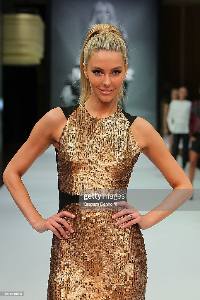 Model Jennifer Hawkins showcases designs by Manning Cartell at the Myer Autumn/Winter 2013 collections launch at Mural Hall at Myer on February 28, 2013 in Melbourne, Australia.