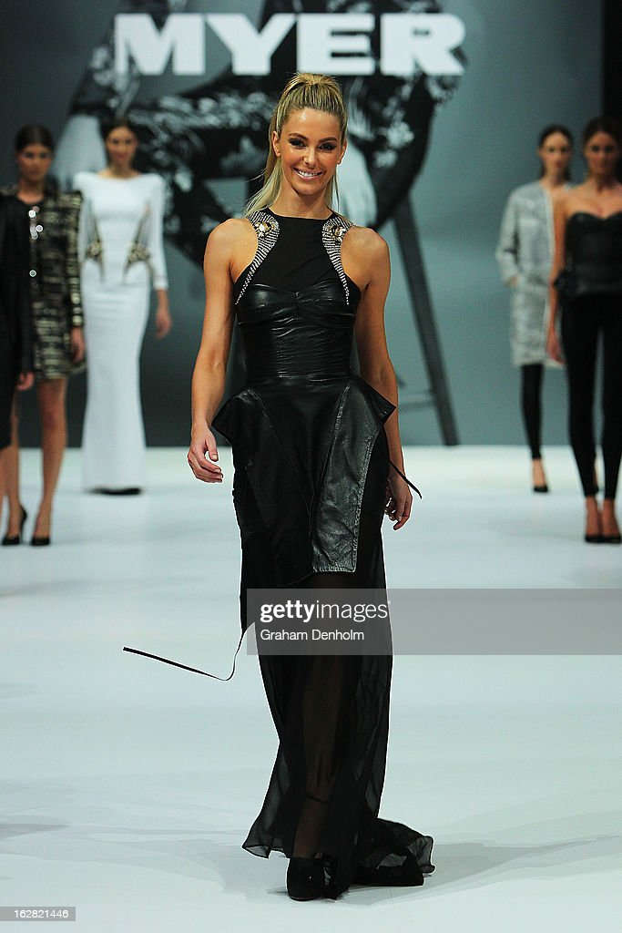 Model Jennifer Hawkins showcases designs by Toni Maticevski at the Myer Autumn/Winter 2013 collections launch at Mural Hall at Myer on February 28, 2013 in Melbourne, Australia.