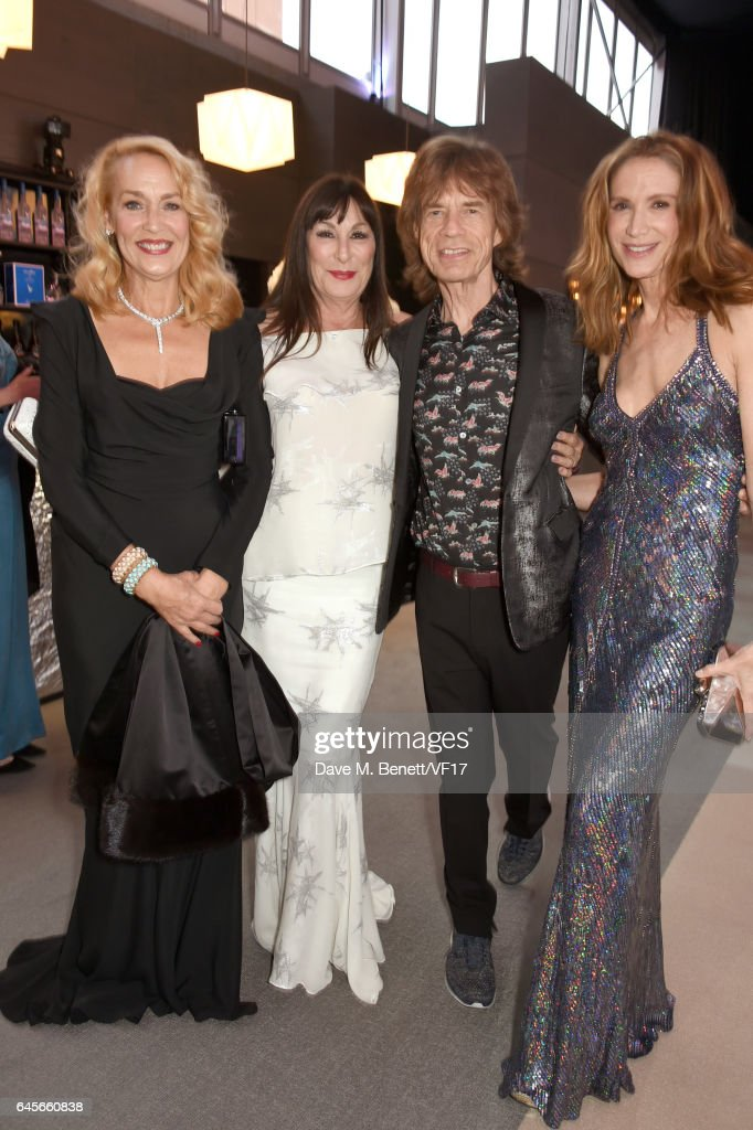 (L-R) Model Jerry Hall, actor Anjelica Huston, recording artist Mick Jagger of music group The Rolling Stones, and actor Kelly Lynch attends the 2017 Vanity Fair Oscar Party hosted by Graydon Carter at Wallis Annenberg Center for the Performing Arts on February 26, 2017 in Beverly Hills, California.