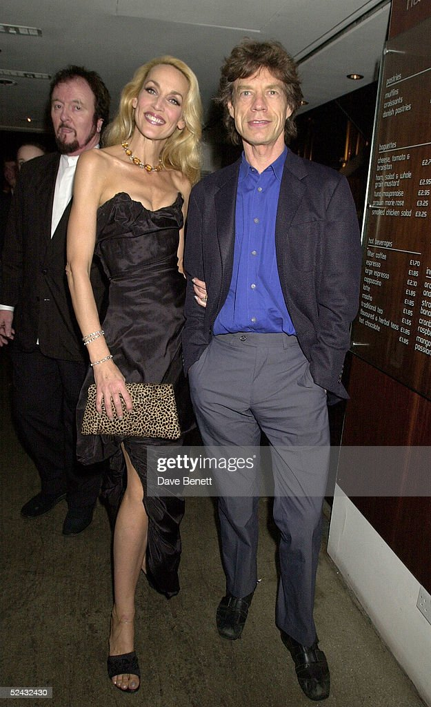 Model Jerry Hall and ex-husband, singer Mick Jagger at the Gielgud Theatre for Jerry's first night starring in The Graduate on August 08, 2000 in London, England.