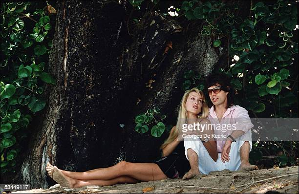 Model Jerry Hall and musician Mick Jagger are seen on the beach February 18 1987 in Barbados