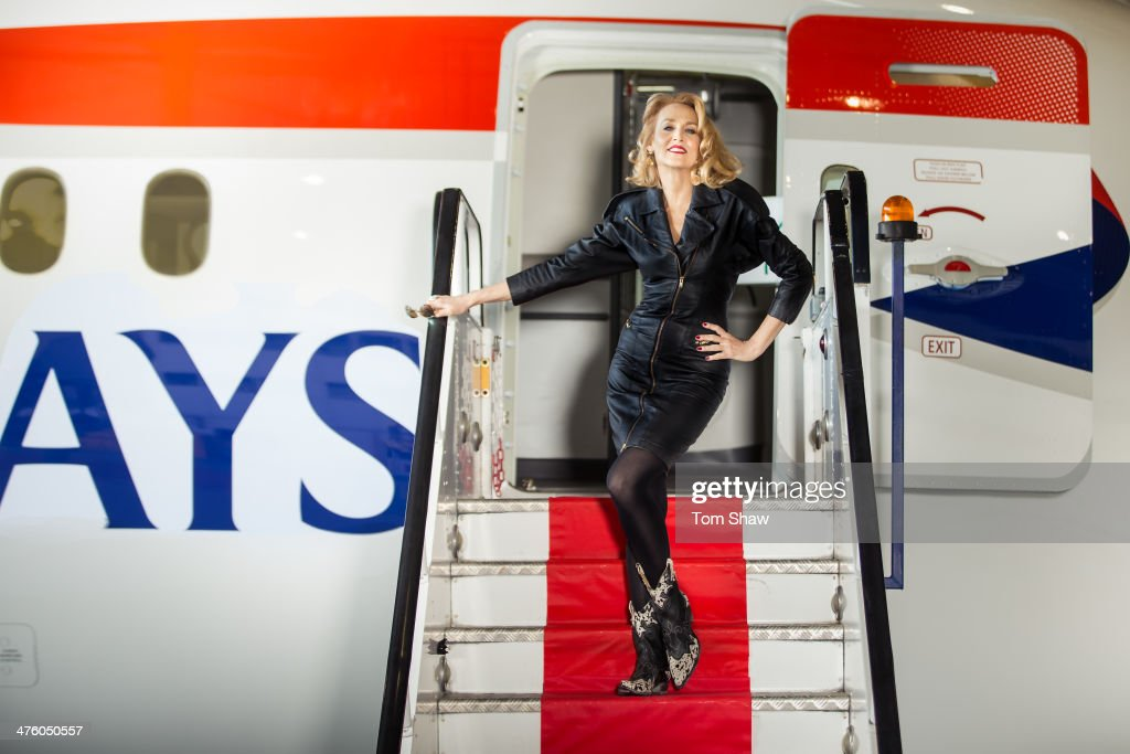 Model Jerry Hall poses on the steps of a British Airways 787 Dreamliner during a photoshoot to launch direct flights to Austin Texas at Heathrow on...