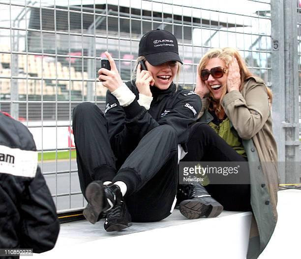 Model Jess Hart and her mother Rae Hart watch as sister Ashley Hart takes off for her lap in the 2 seater Formula 1 car ahead of the 2011 Australian...