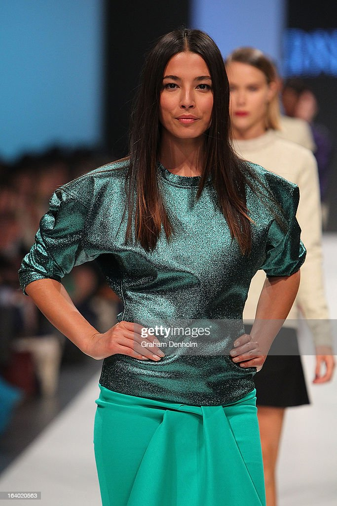 Model Jessica Gomes showcases designs by Scanlan & Theodore during the L'Oreal Melbourne Fashion Festival Opening Event presented by David Jones at Docklands on March 19, 2013 in Melbourne, Australia.