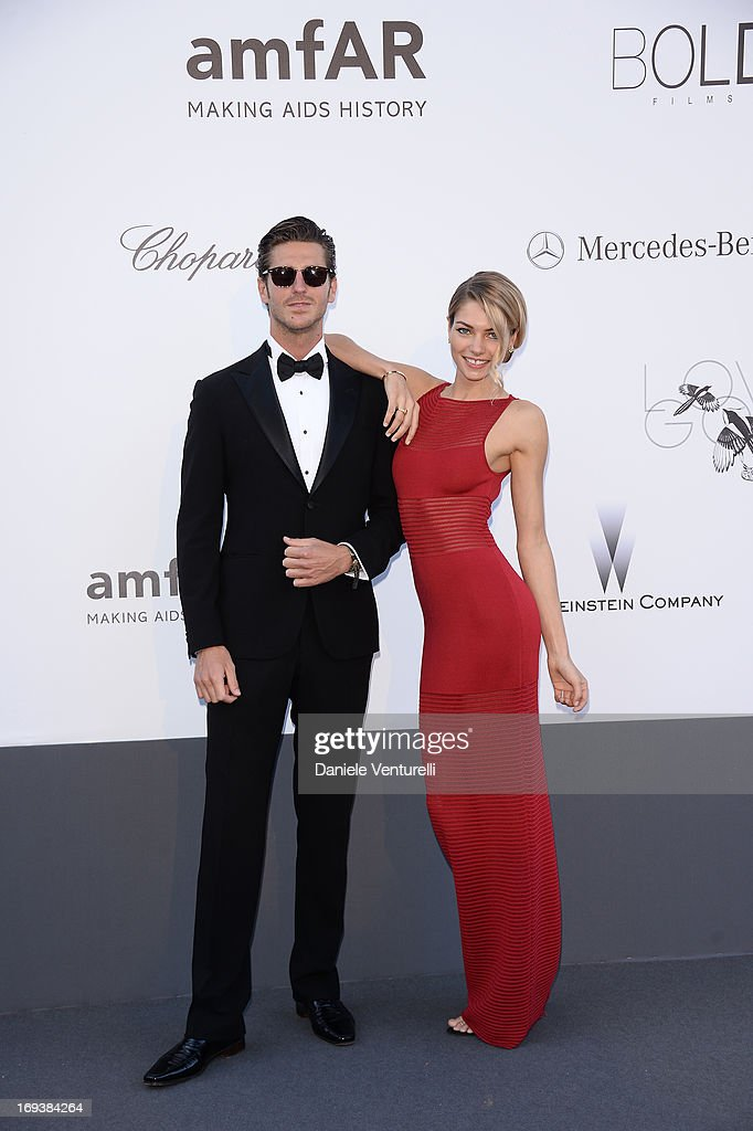 Model Jessica Hart (R) and guest attends amfAR's 20th Annual Cinema Against AIDS during The 66th Annual Cannes Film Festival at Hotel du Cap-Eden-Roc on May 23, 2013 in Cap d'Antibes, France.
