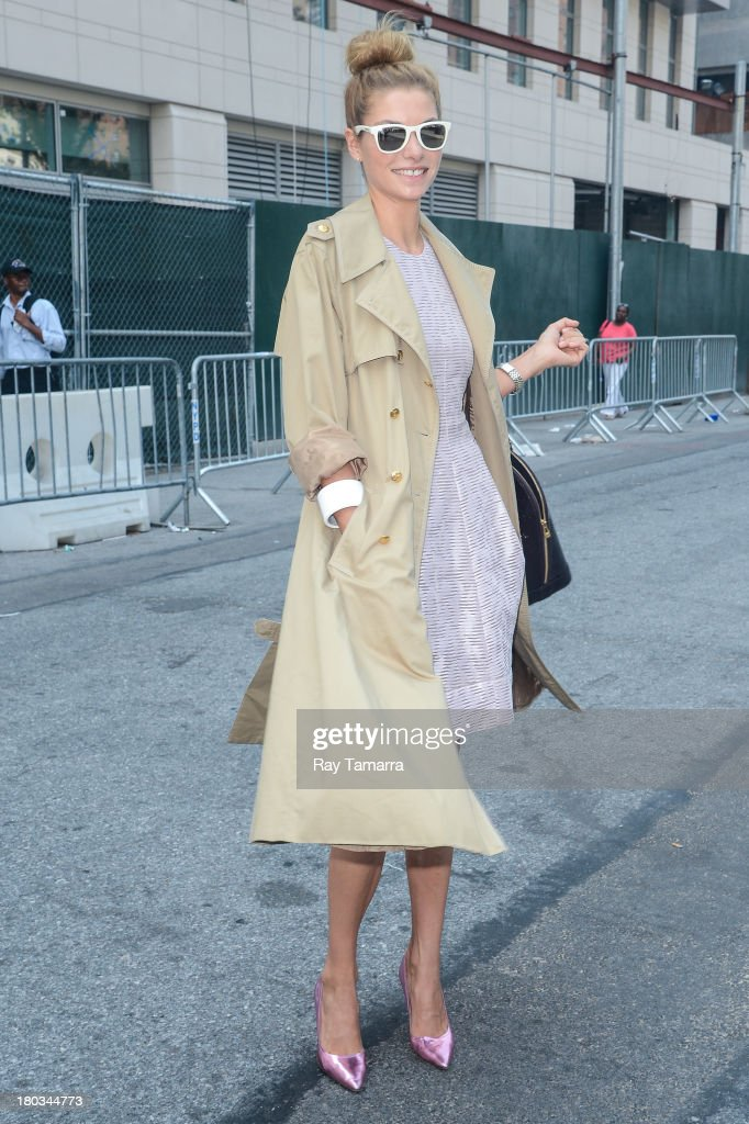 Model <a gi-track='captionPersonalityLinkClicked' href=/galleries/search?phrase=Jessica+Hart&family=editorial&specificpeople=4436555 ng-click='$event.stopPropagation()'>Jessica Hart</a> enters the Mercedes-Benz Fashion Week at Lincoln Center for the Performing Arts on September 11, 2013 in New York City.