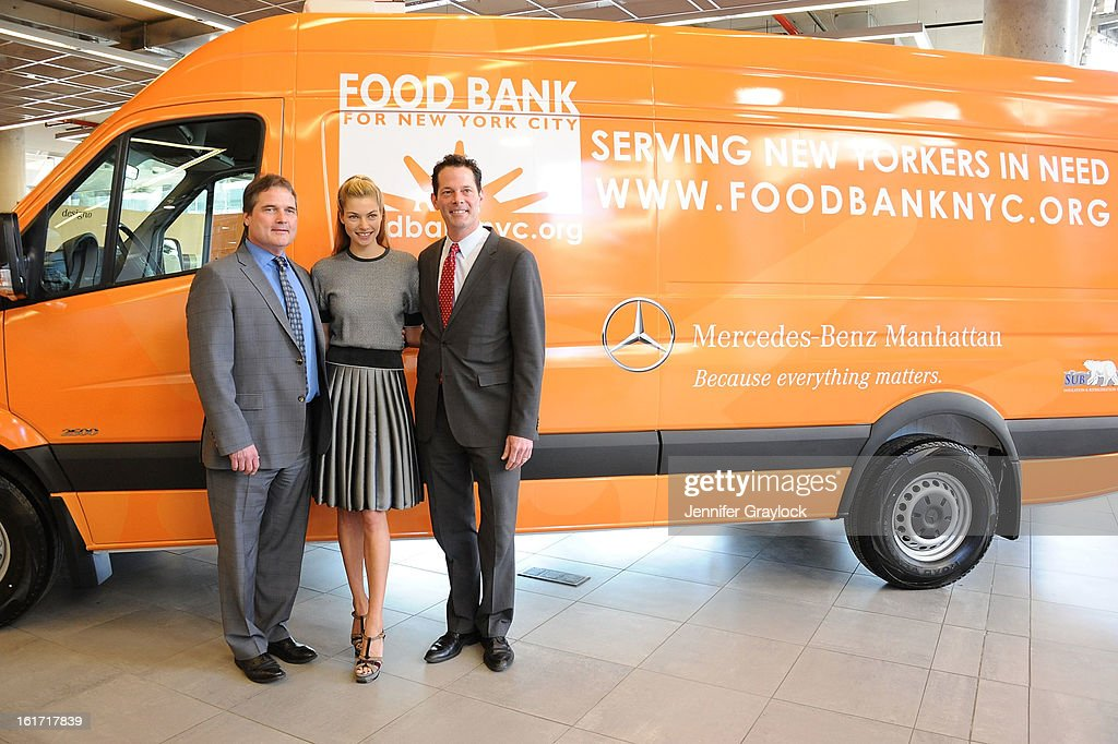 Model Jessica Hart, General Sales Manager Mercedes-Benz Manhattan Tom Shanley and General Manager Mercedes-Benz Manhattan Blair Creed unveils the Food Bank For New York City's Sprinter Van Donated By Mercedes-Benz Manhattan at the Mercedes-Benz 11th avenue on February 14, 2013 in New York City.