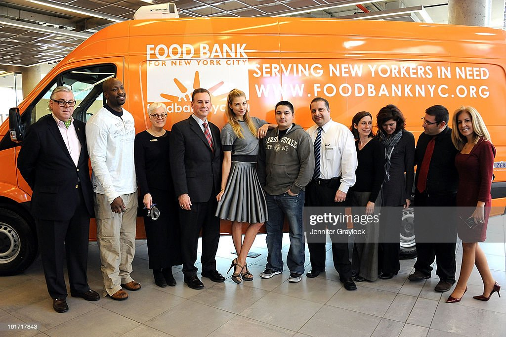 Model Jessica Hart with Mercedes-Benz Manhattan Volunteers unveil the Food Bank For New York City's Sprinter Van Donated By Mercedes-Benz Manhattan at the Mercedes-Benz 11th avenue on February 14, 2013 in New York City.