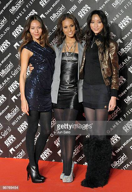 Model Jessica Michibata singer Alicia Keys and actress Anne Watanabe attend the photocall during Alicia Keys's latest album promotion 'The Element Of...